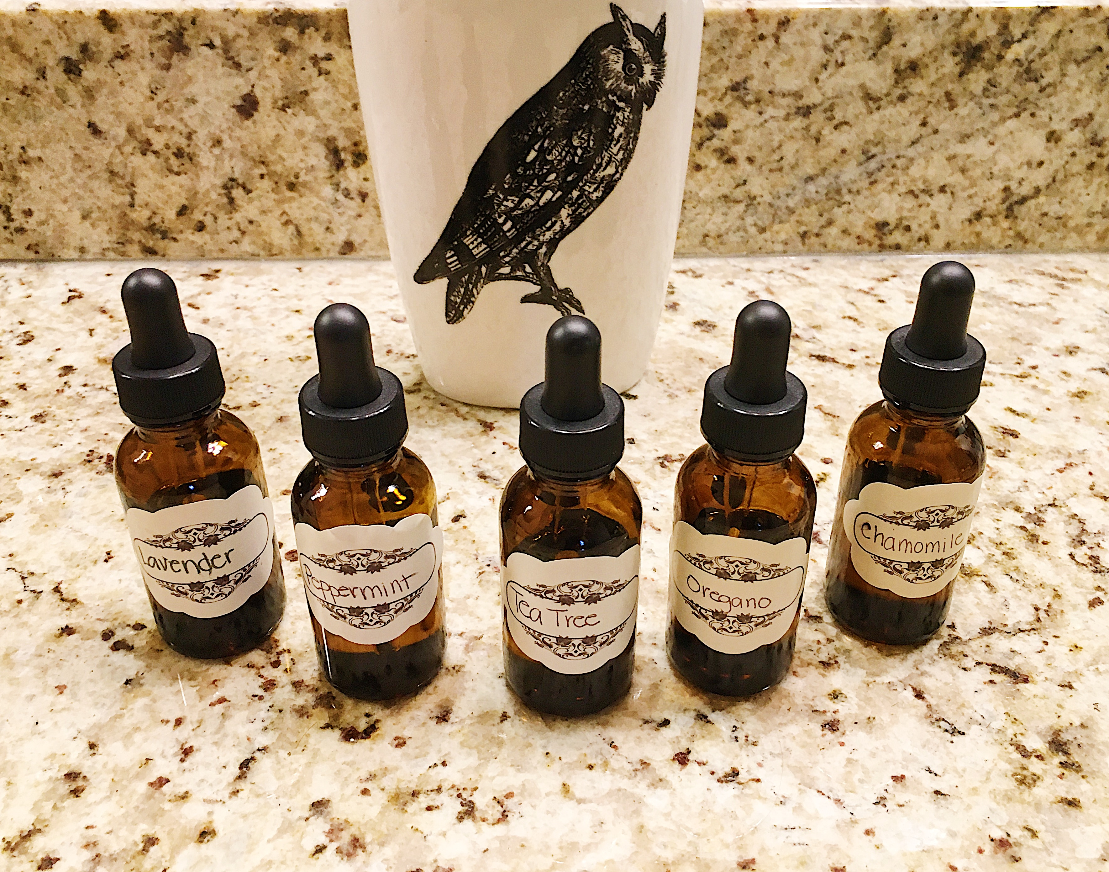 A lineup of the diluted essential oils I made in glass bottles with labels