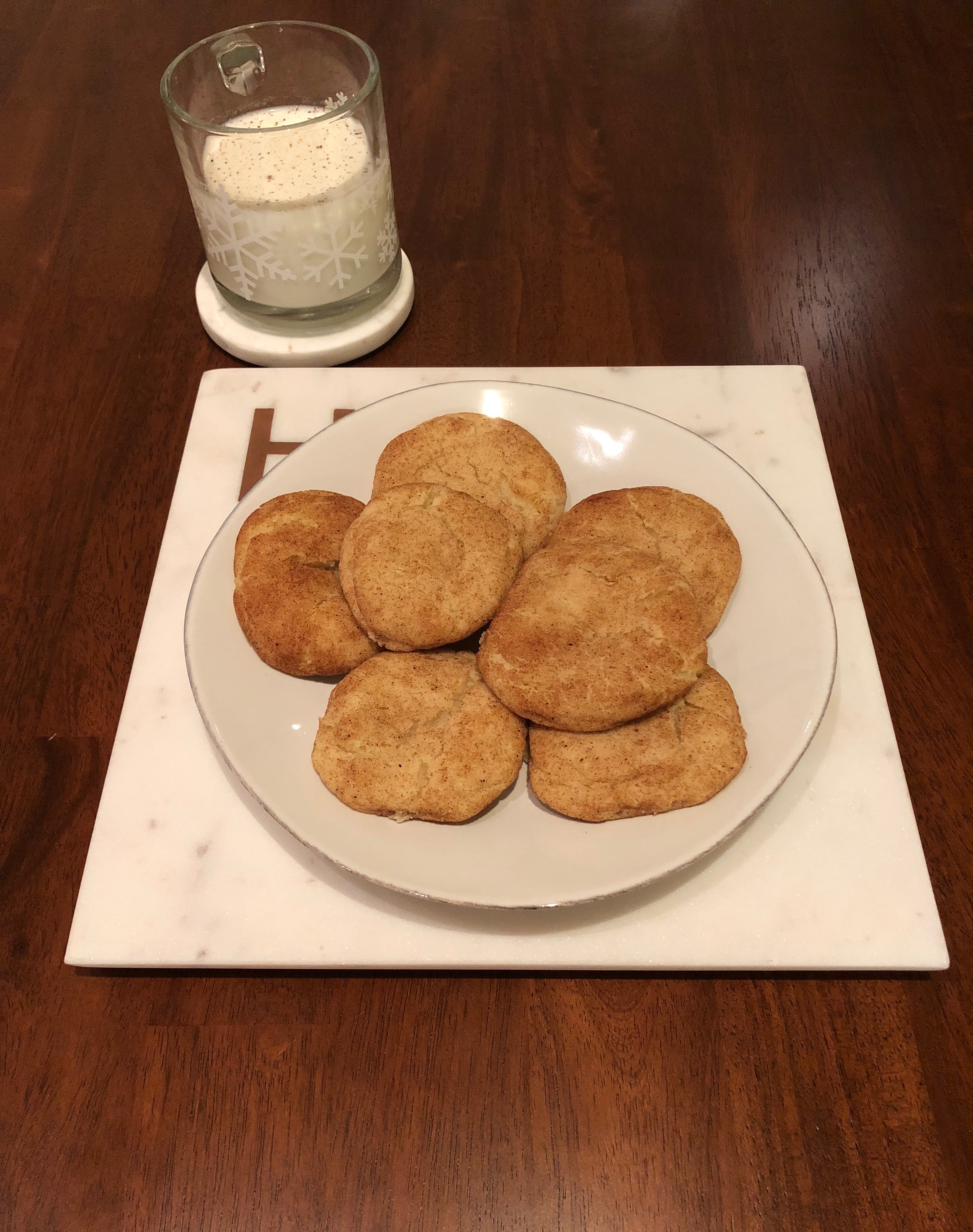 Plate of snickerdoodles and glass of milk with nutmeg